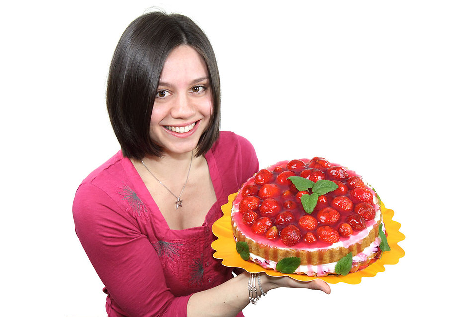 9542-a-beautiful-woman-holding-a-strawberry-cake-isolated-on-a-white-backgrou-pv