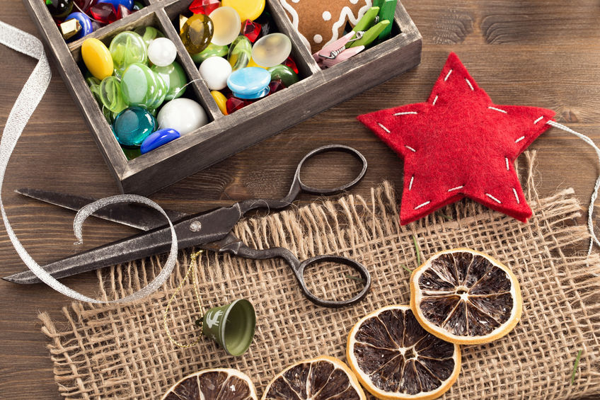 46351005 - hand crafted holiday ornaments and vintage scissors top view